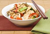 foto of crimini mushroom  - Stir fried chicken with mushrooms served over rice.