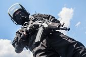 pic of terrorist  - Spec ops soldier in black uniform and face mask with his rifle