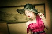 stock photo of vaudeville  - Charming blonde woman with black hat - JPG