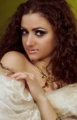 foto of auburn  - Young Arabian woman in sari with thick auburn hair.