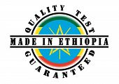 foto of ethiopia  - Quality test guaranteed stamp with a national flag inside Ethiopia - JPG