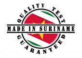 pic of suriname  - Quality test guaranteed stamp with a national flag inside Suriname - JPG