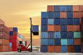 image of car carrier  - forklift handling the container box at dockyard - JPG