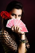 stock photo of gypsy  - Gypsy woman with fan of cards and mysterious look - JPG