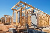 stock photo of suburban city  - new suburban homes currently under construction in row - JPG