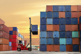image of forklift  - forklift handling the container box at dockyard - JPG