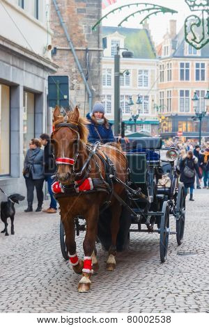 Horse carriage and tourists on Markt square of Brugge Christmas