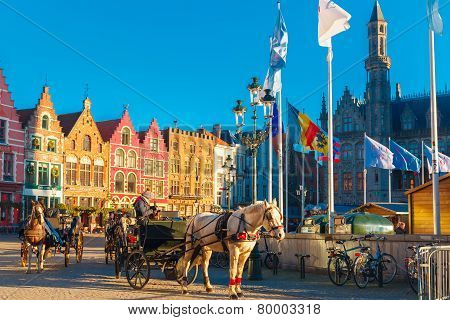 Horse carriage at Christmas morning on Markt square of Brugge