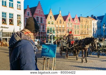 Street artist paints a Horse carriage of Brugge Christmas