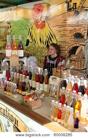 A Stall With Syrups And Flavoring In Bottles