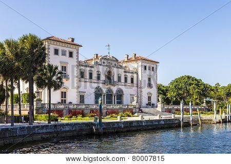 MIAMI, USA - MAY 6, 2012: Miami Vizcaya museum at waterfront under blue sky