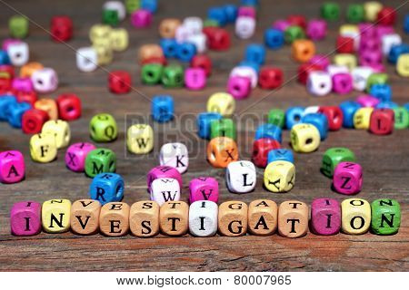 Sign Investigation And Many Wooden Cubes With Letters