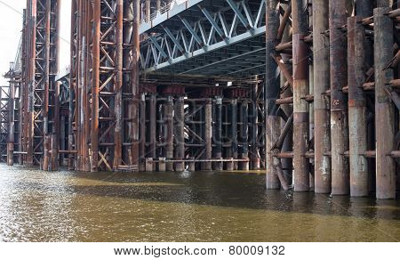 Bridge Construction. Rusty Metal Piers.