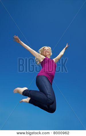 Happy Blonde Woman Jumping High