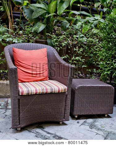Rattan Chair And Rattan Coffee Table With Green Trees At Outdoor