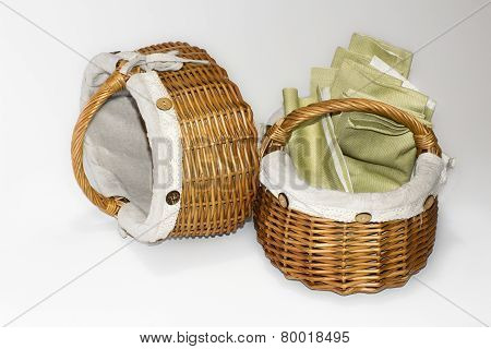 Two Wicker Baskets With Linen Cloth