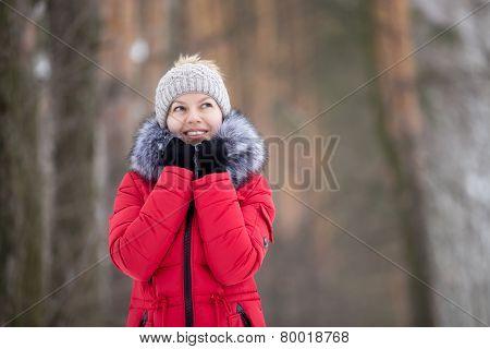 Female Portrait Outdoors In Red Winter Jacket