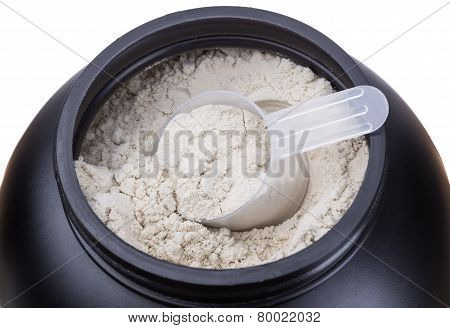 Container Of Milk Whey Protein. Close-up.