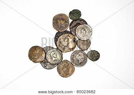 Many Ancient Bronze And Silver Coins On A White Background