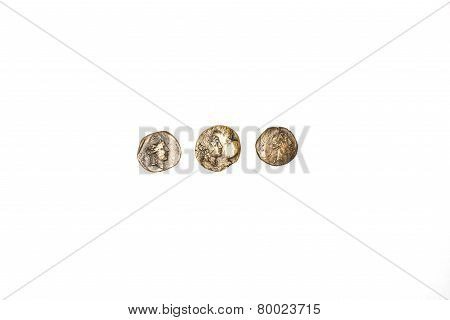 Three Ancient Bronze Coins On A White Background