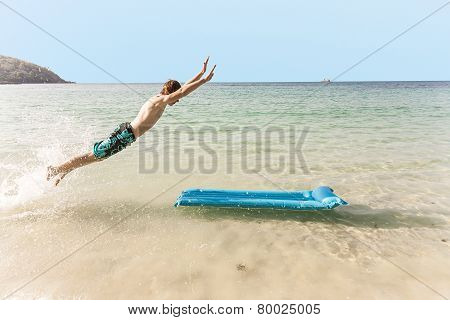Boy With Red Hair Is Enjoying Jumping On The Air Mattress