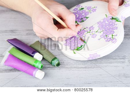 Hand paints on hand made cutting board and art materials