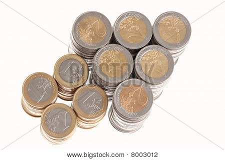 Columns of euro coins in shape of arrow pointing up right isolated on white background