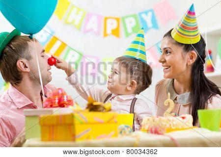 family having fun at kid birthday party