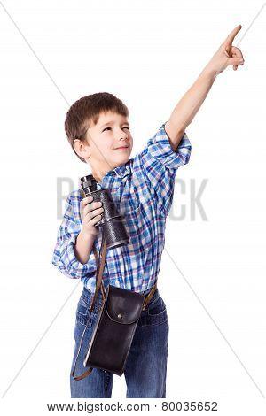 Boy standing with spyglass