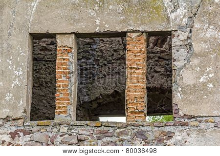 Empty Window Hole Giving View To Ruins