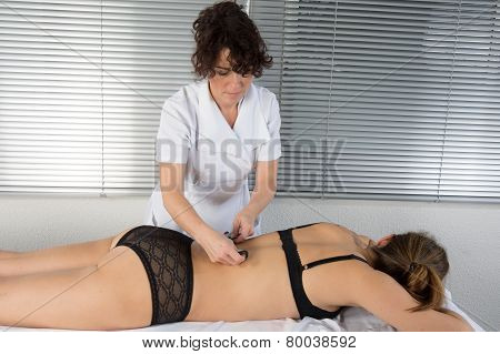 Woman Is Doing Massage Of Electrostimulator For The Spine