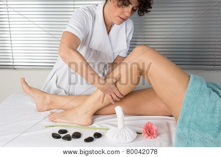 Physiotherapist Massaging The Calves Of A Woman