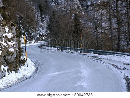 Dangerous Curve Of A Frozen Mountain Road