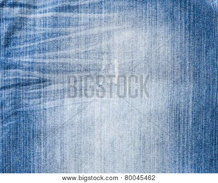 Texture of threadbare denim of indigo color