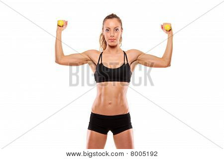 Young attractive woman with weights