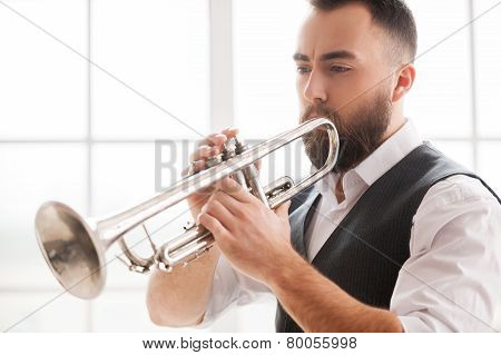 Improvising With His Trumpet.