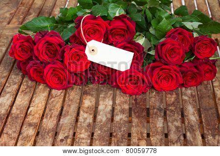 dark red roses and tag
