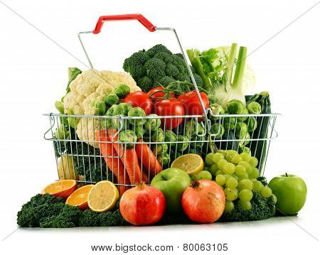 Shopping Basket With Assorted Raw Organic Vegetables Over White