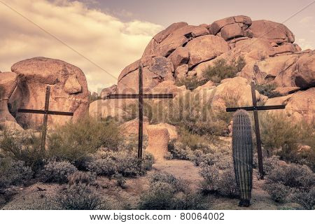 Crosses in desert rocky boulder location - image cross processed
