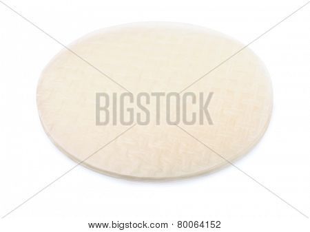Stack of rice paper sheets isolated on white