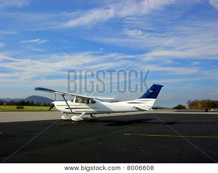 Small Cessna airplane on ramp