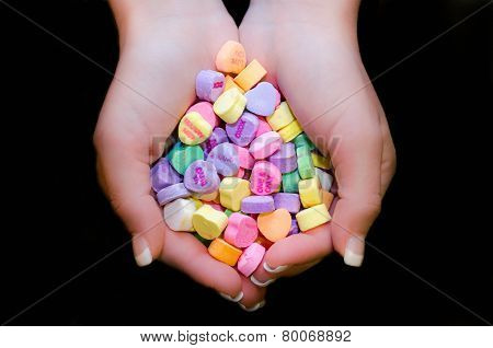 Holding candy hearts