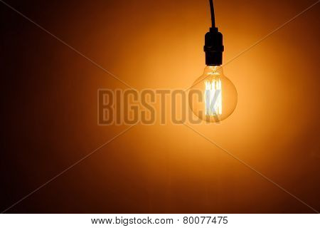 bulb lamp with warm light, copy-space background