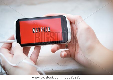 Netflix Service Logo On Phone