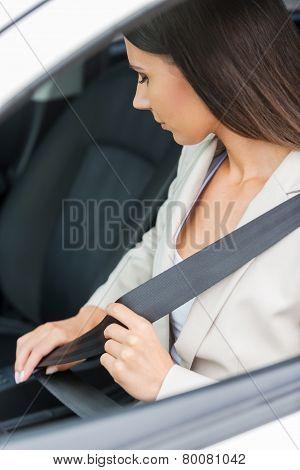 Fastening Her Seat Belt.