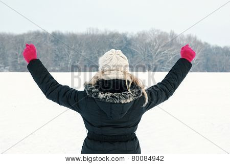 Winter Woman In Snow Showing Her Back And Facing Forest