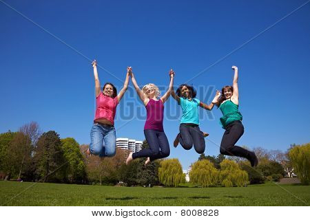 Four Women Jumping In The Air