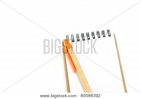 Notepad And Orange Pen Isolated On White Background
