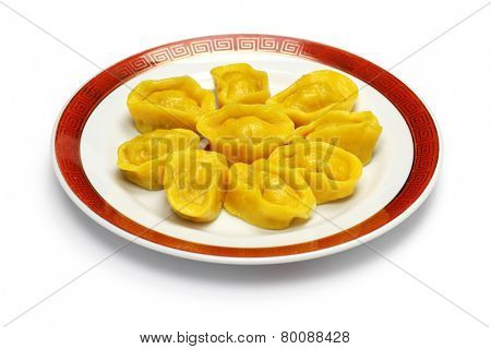 homemade chinese gold ingot dumplings isolated on white background, new year food, spring festival food