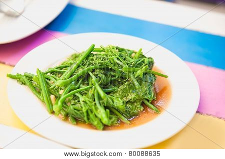 Closeup Of Stir Fried Young Chayote Leaf With Garlic